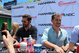 Richard Armitage signing while Hugh Dancy looks at me taking a picture