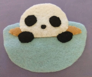 Panda hands, eyes, and nose added to teacup body