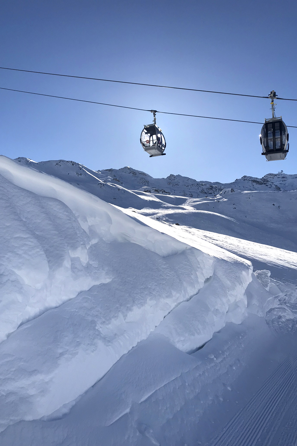Blue skies skiing in Les Trois Vallees, France - travel & lifestyle blog
