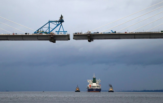 A tanker carrying US shale gas passes under the Queensferry Crossing bridge