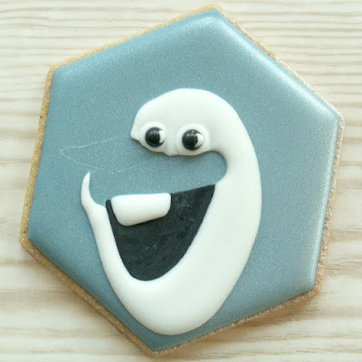 Blue cookie with Olaf's mouth, eyes, teeth and face piped, photo by Honeycat Cookies