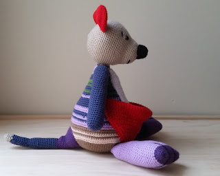 Right hand view of the crocheted mother kangaroo. She is facing the right side of the screen.