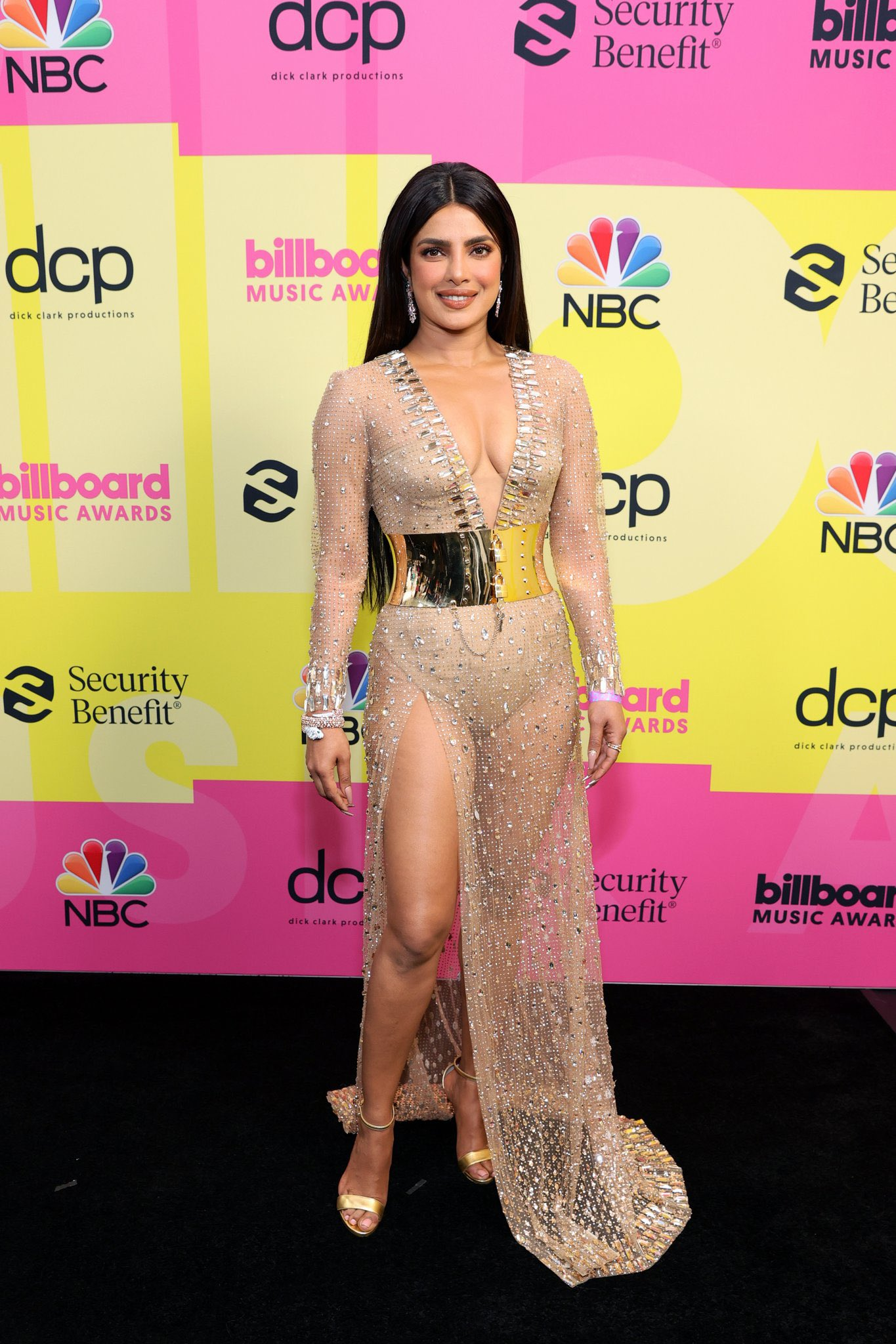 Priyanka Chopra in a sheer crystal-embellished from dolce and gabbana  with a plunging neckline and thigh-high slit for the BBMAs.