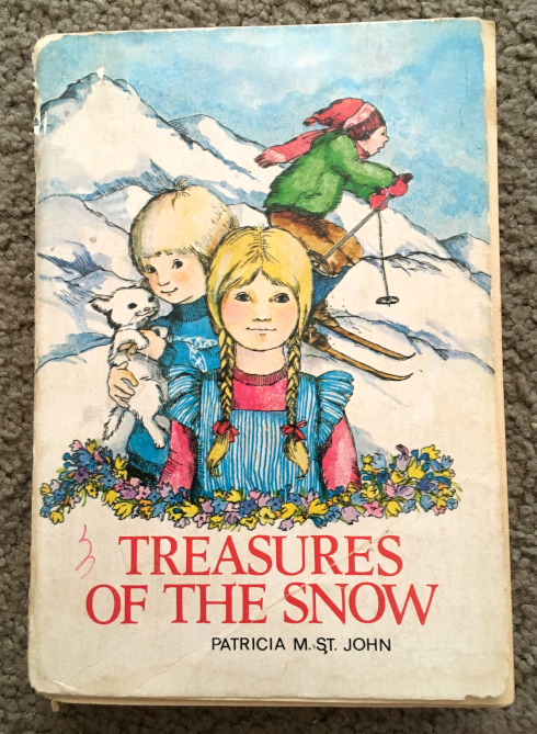 Treasures of the Snow by Patricia St. John - a well worn and beautiful Christian children's book that was the most powerful story about forgiveness I ever read.