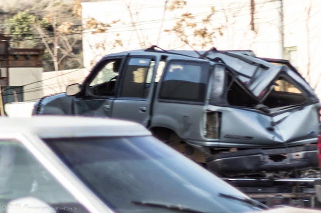 crushed Ford Explorer