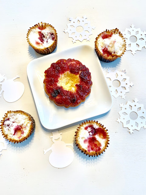 Cranberry Champagne Cupcakes: White cupcakes with cranberry sauce in the middle.