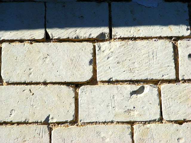 Masons marks on an old building. Indre et Loire. France. Photo by Loire Valley Time Travel.