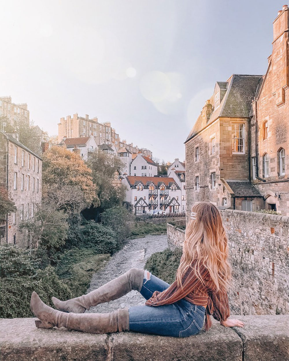 travel blogger Amanda Martin looks over Dean Village in Edinburgh
