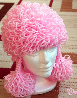 http://www.craftsy.com/pattern/crocheting/accessory/pink-poodle-hat/73866