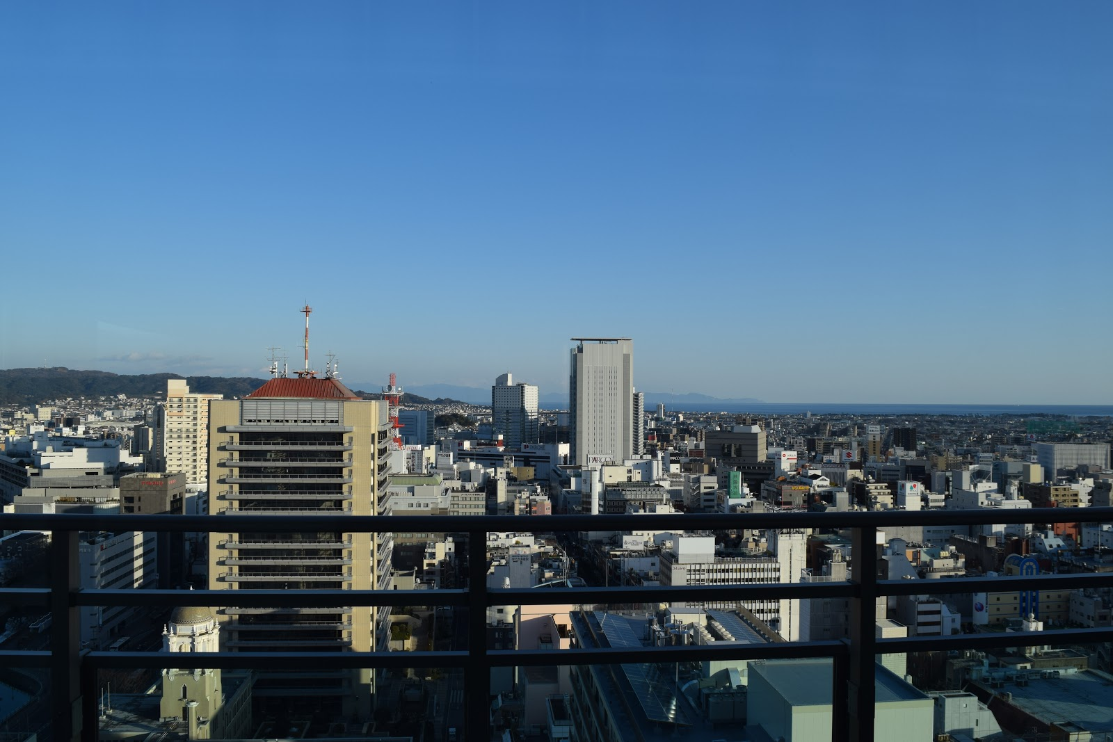 The view of Shizuoka city and the sea from my friend's apartment building