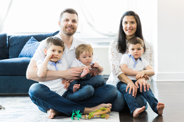 the family poses on the floor during their at home family portraits