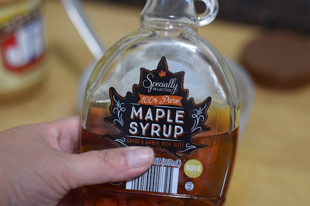 A bottle of maple syrup.