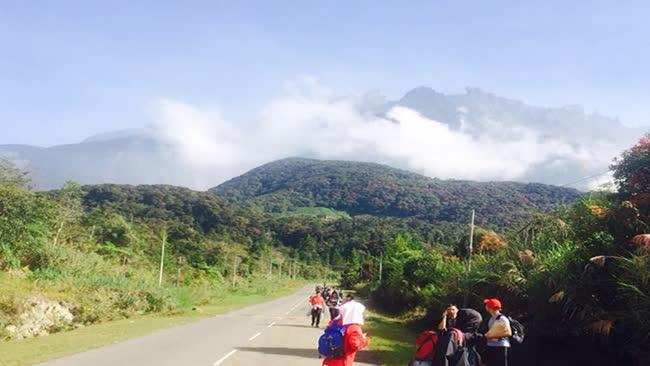 Tourists walk away from Mount Kinabalu hours after a magnitude 5.9 earthquake shook the area in Kundasang, Sabah, Malaysia.