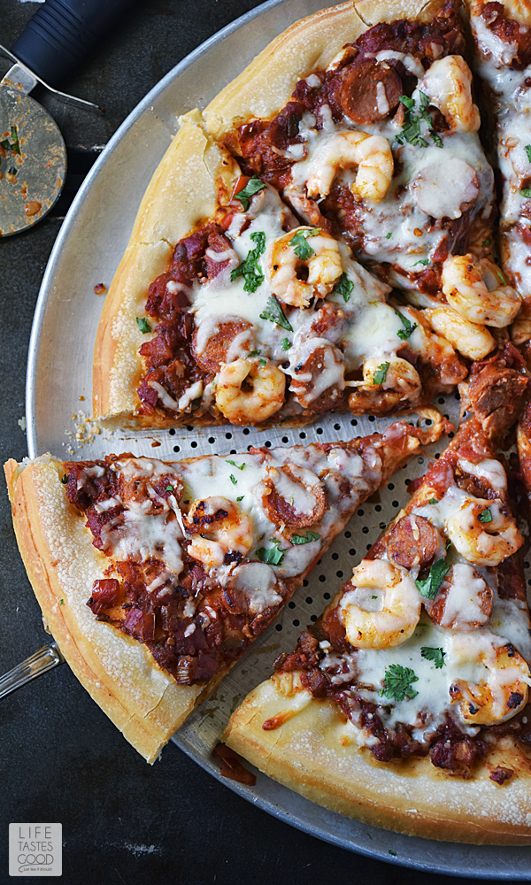 Cajun seasoned shrimp, Andouille sausage, the holy trinity of vegetables, and a zesty sauce all atop a soft and chewy pizza crust makes up this Jambalaya Pizza recipe. Who needs a bowl?! #LTGrecipes