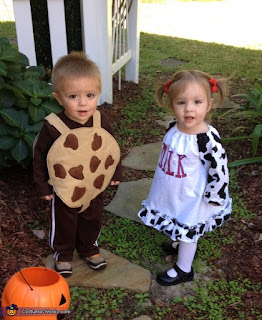 Twin Halloween costume with cookies and milk.