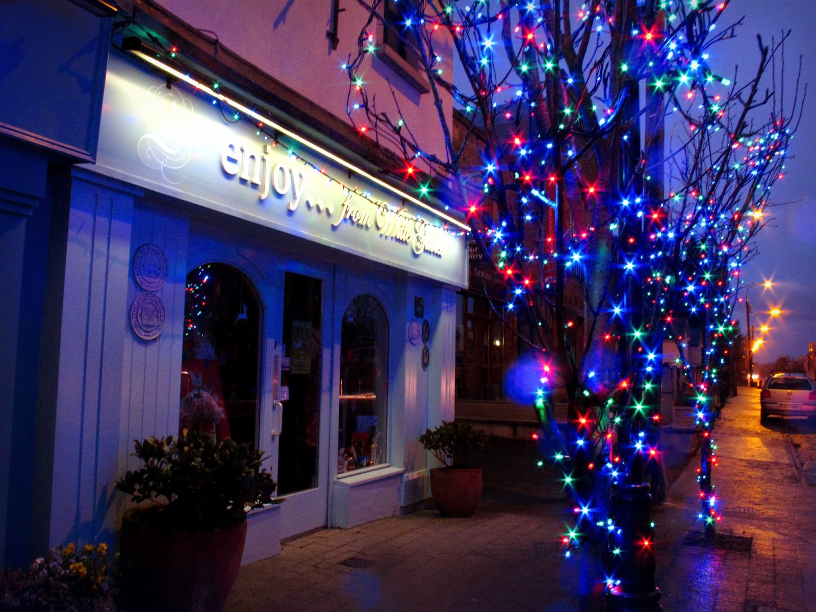 the Enjoy cafe entrance and Christmas lights decorations