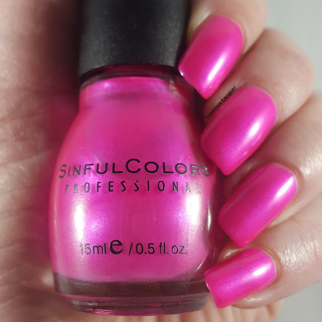 Bright pink nail polish with iridescent shimmer