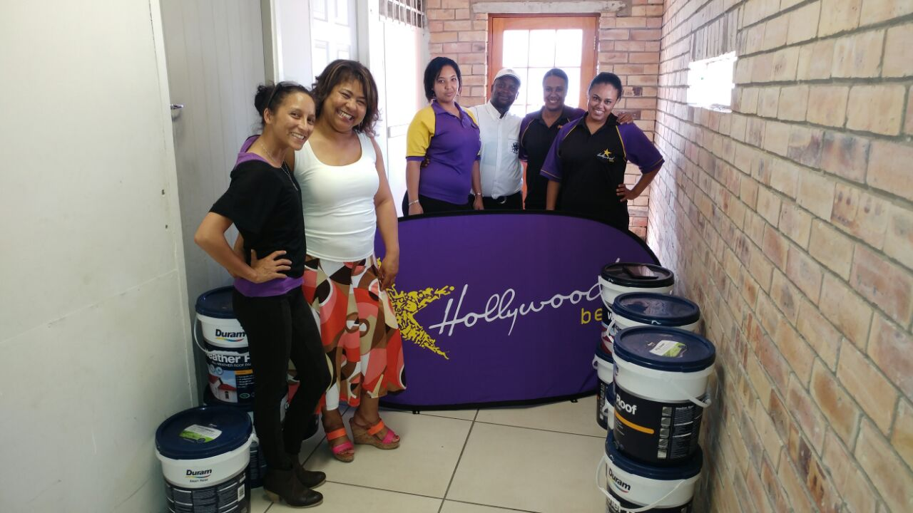 Alpha Primary School staff members are happy to receive a much-needed donation from Hollywoodbets Korsten