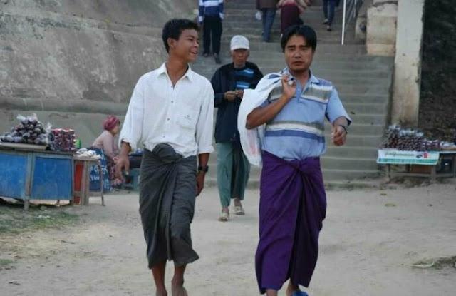 Os homens de Myanmar vestem Páscoa ou Thami