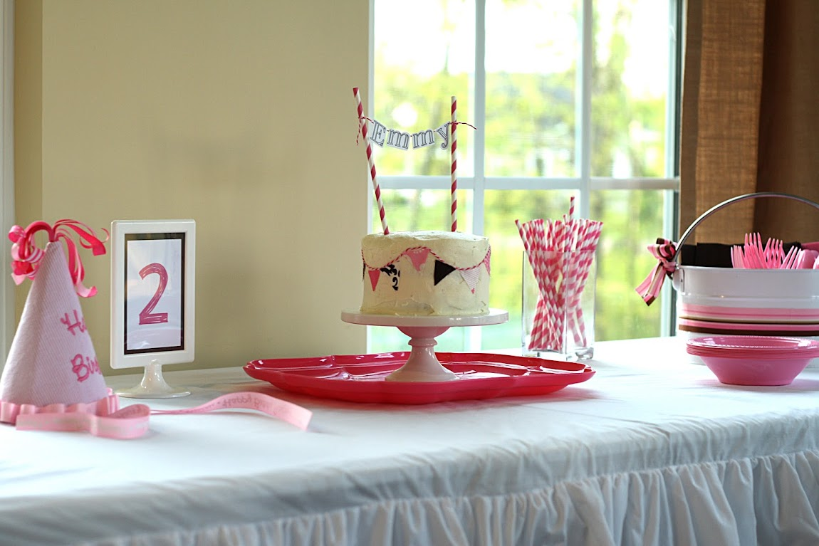 pink and brown diy birthday party table with ruffled table cloth