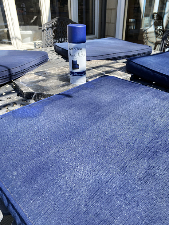 Can of navy spray paint for cushions and the cushions