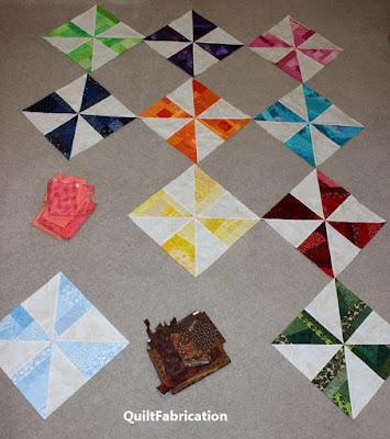 scrap pinwheel quilt blocks in a rainbow of colors