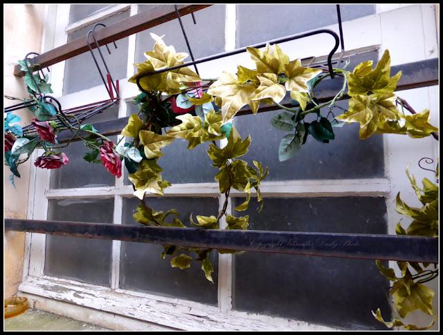 Window with plastic flowers Versailles