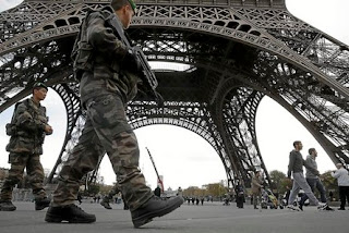 soldiers patrol Paris
