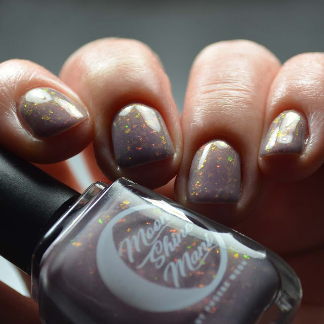 purple flakie nail polish swatch low light