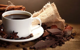 a coffee cup and gormet chocolate