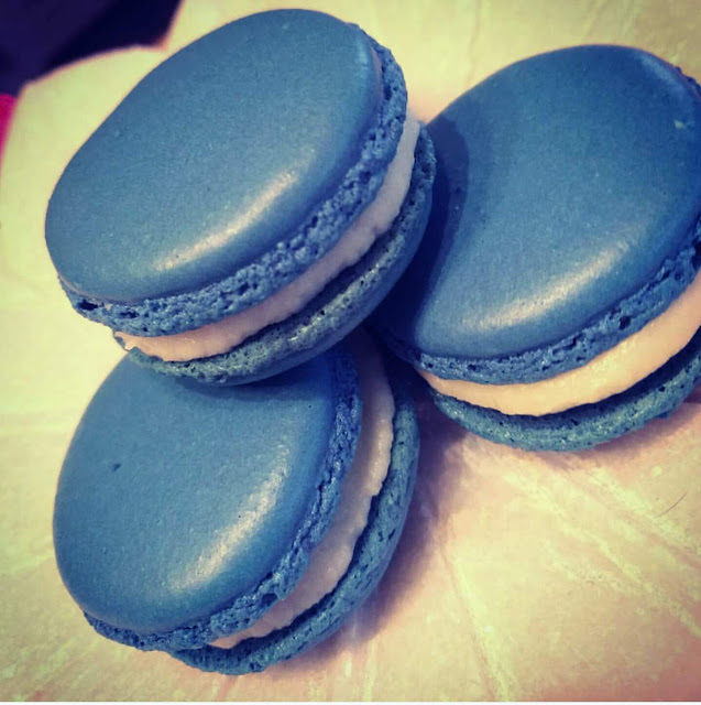 Blue shelled macarons filled with cream cheese icing and lemon curd