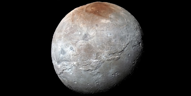 NASA's New Horizons spacecraft captured this high-resolution, enhanced color view of Pluto's largest moon, Charon, just before closest approach on July 14, 2015. The image combines blue, red and infrared images taken by the spacecraft's Ralph/Multispectral Visual Imaging Camera (MVIC); the colors are processed to best highlight the variation of surface properties across Charon. Scientists have learned that reddish material in the north (top) polar region – informally named Mordor Macula – is chemically processed methane that escaped from Pluto's atmosphere onto Charon. Charon is 754 miles (1,214 kilometers) across; this image resolves details as small as 1.8 miles (2.9 kilometers). Credits: NASA/Johns Hopkins University Applied Physics Laboratory/Southwest Research Institute