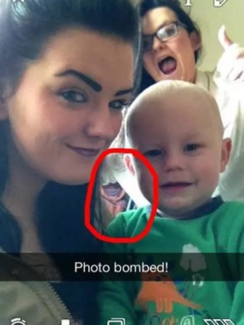 A mysterious girl appears suddenly in the selfie photo of the mother and child