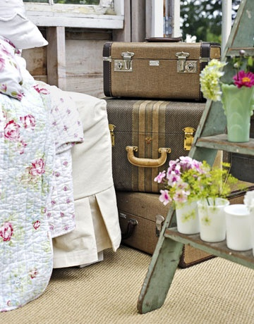 These vintage suitcases pair well with the florals.