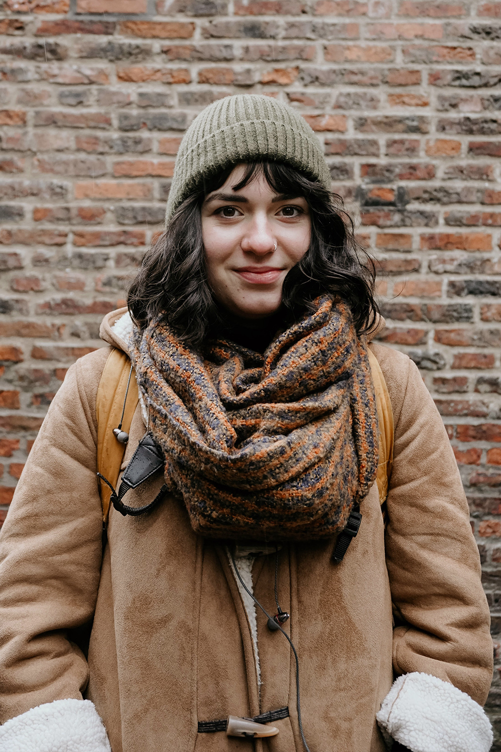 a woman wearing fall outfit with infinity scarf