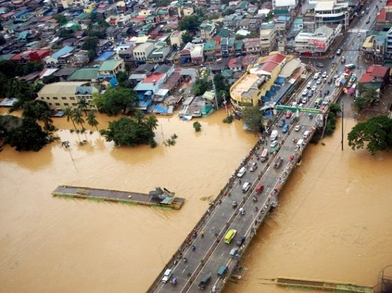 Photo taken on August 8, 2012 and released by the Department of National Defense (DND) shows an aerial shot of the overflowing Marikina river in suburban Manila