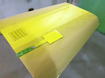 Four coats of Sulfur Yellow paint were used to spray the bonnet stripe