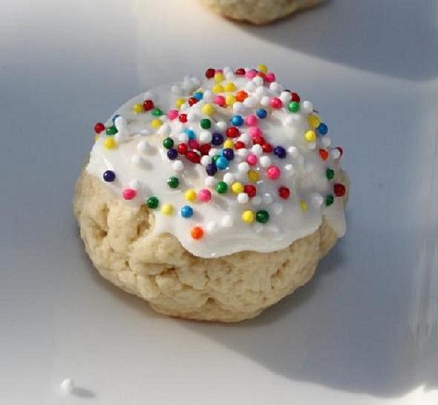 old fashioned Italian soft cookies with frosting and assorted candies on top
