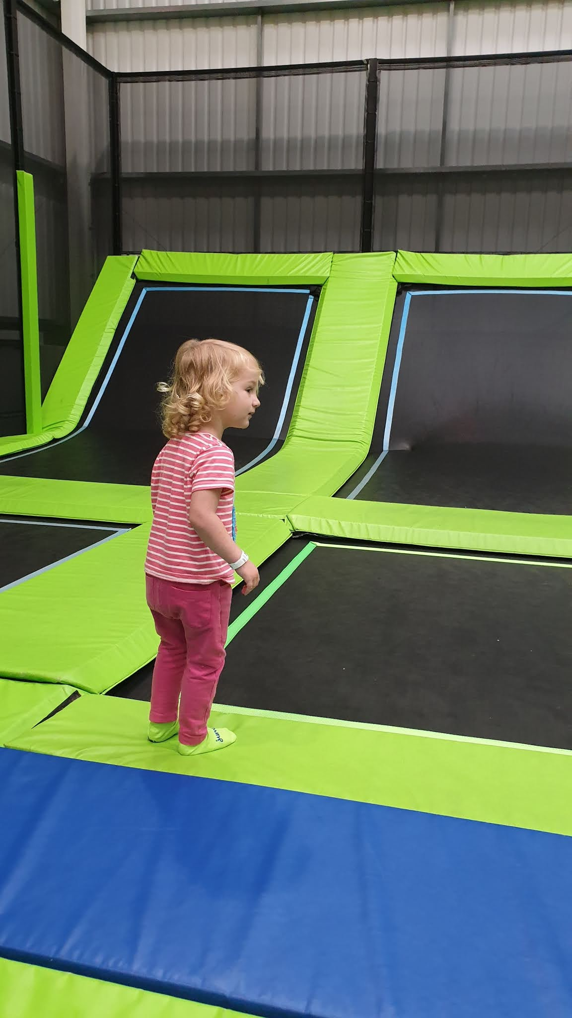 toddler about to jump on a trampoline