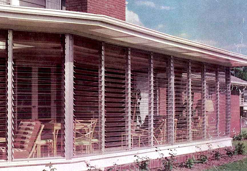 1950 glass louvres on a sun room, a color photograph