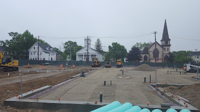 the foundation is in and utility work being done for the new building at 150 Emmons St