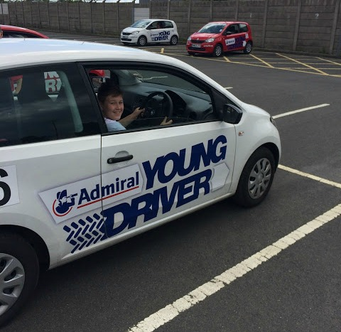boy sat in a young driver car having his first driving lesson