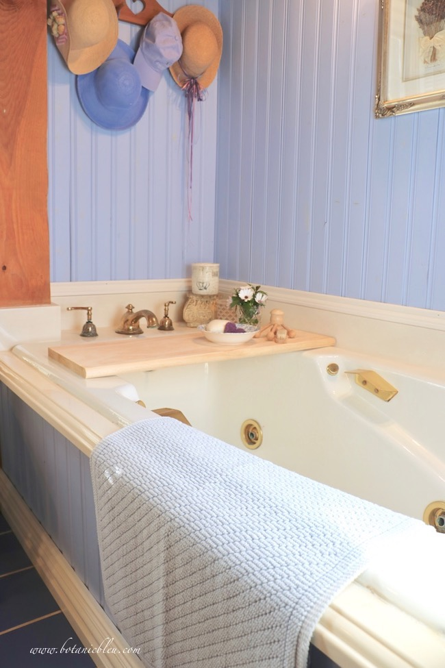 DIY wood bathtub tray creates French Country charm in master bath