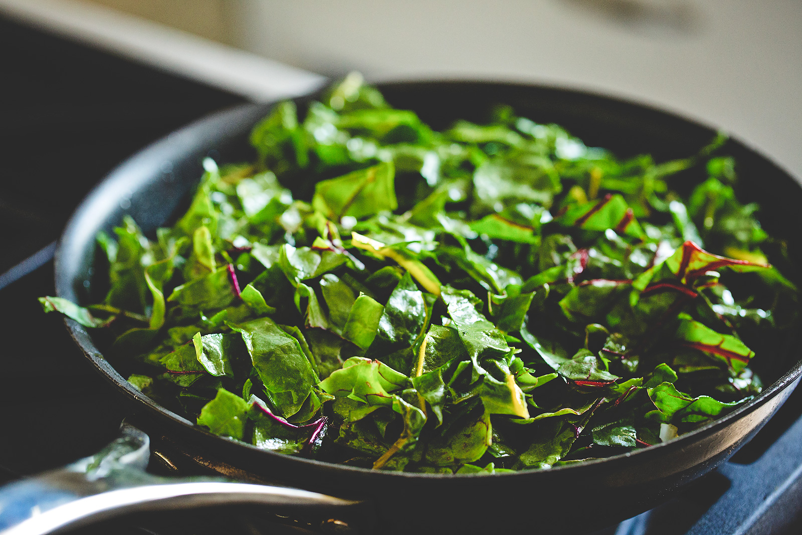 Chard in a skillet on the stove.