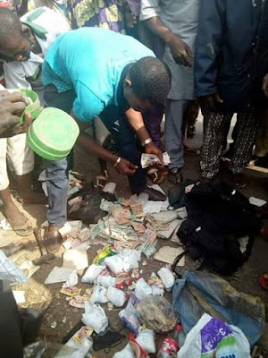 'Mad' man caught along Lagos-Ibadan expressway with bag filled with used sanitary pads and diapers (photos)