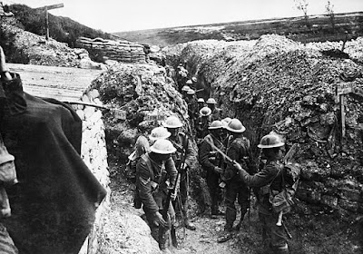 Armed soldiers in a WW1 trench