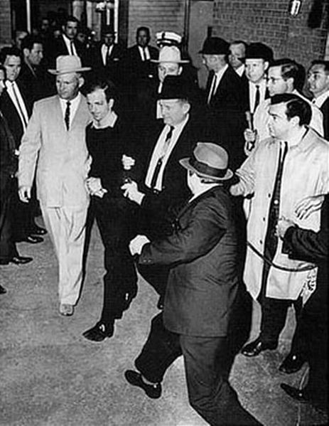 Ruby about to shoot Oswald who is being escorted by Dallas police.