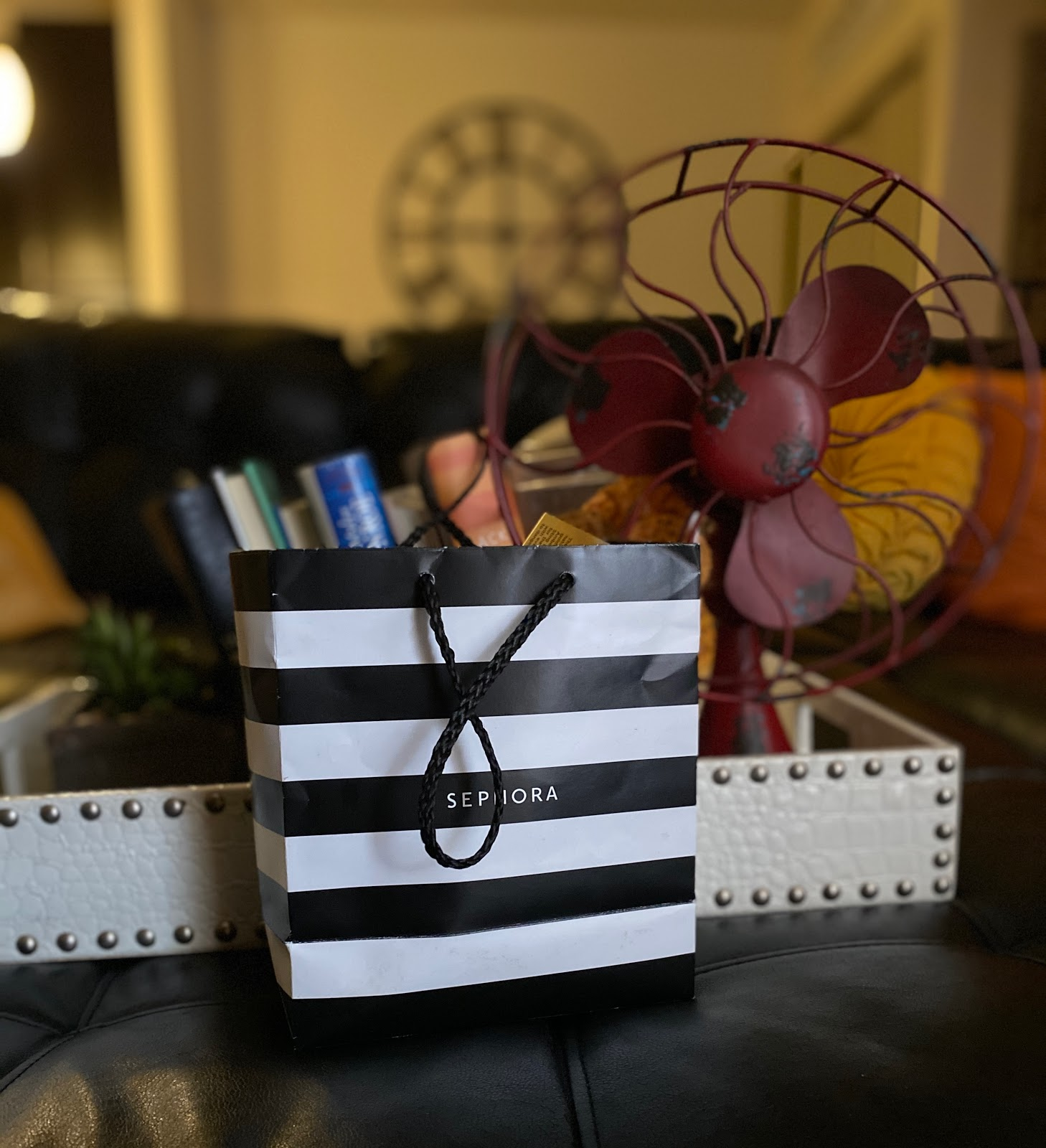 Image: Sephora bag filled with new current beauty items. such as eye shadow, lip gloss, beauty blender