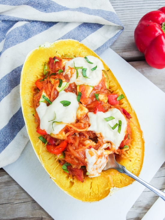 This vegan pizza stuffed spaghetti squash with creamy vegan mozzarella is pure comfort food, but healthier!