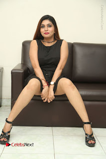 Tollywood Upcoming Actress Pooja Roshan Stills in Black Short Dress at Plus 1 Movie Trailer Launch  0351.JPG